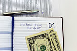 writing down in a notebook about a debt
