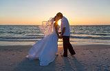 Bride and Groom Married Couple Sunset Beach Wedding