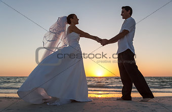 Bride and Groom Married Couple Sunset Beach Wedding