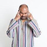 Indian man thinking