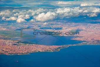 Aerial view of the city and sea, sunny day