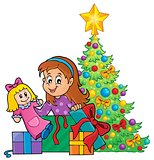 Girl unpacking Christmas gifts theme 1