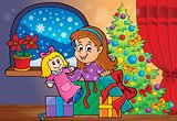 Girl unpacking Christmas gifts theme 2