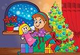 Girl unpacking Christmas gifts theme 2