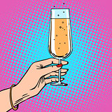 Toast a female hand with glass of champagne celebration party