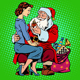 Christmas gift. Santa Claus and a beautiful girl