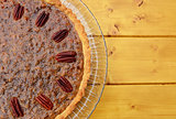 Half pecan pie served on a glass plate