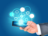 Businessmans hand using smartphone