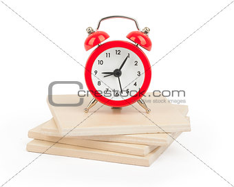 Alarm clock on paving tiles