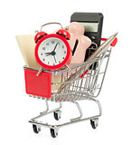 Piggy bank with alarm clock in shopping cart