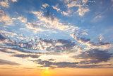 Amazing Sundown Sky with Beautiful Clouds and Sunbeams