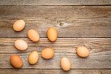 brown chicken eggs on rustic wood