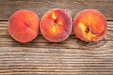 peach fruits on weathered wood