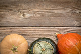 rustic wood background with winter squash