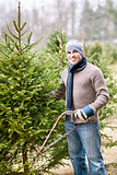 Man cutting Christmas tree
