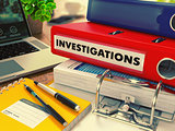 Red Office Folder with Inscription Investigations.