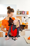 Portrait of mother with girl in halloween bat costume