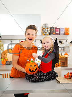 Portrait of girl in halloween bat costume with mother