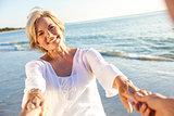 Happy Senior Couple Walking Holding Hands Tropical Beach