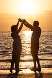 Senior Couple Holding Hands Sunset Tropical Beach