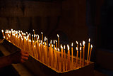 Rows of burning candles .