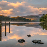 Reflections on Loch Ard, Scotland at sunrise