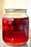 Jar of delicious homemade red cherry compote