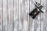 Vintage photo camera on a wooden background