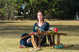 Serious Priestess with Pagan Altar
