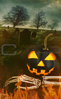 Black pumpkin with skeleton hand with graveyard