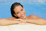 Beauty woman with perfect skin and teeth in a pool