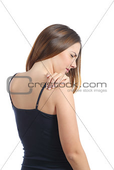 Casual woman suffering shoulder pain