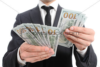 Close up of a business man hands counting banknotes