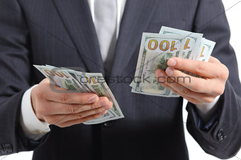 Close up of a business man hands counting money