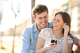 Couple listening to the music from a smart phone