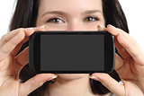 Funny woman showing a blank smart phone screen