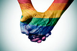 gay couple holding hands, patterned as the rainbow flag