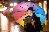 Woman with Tablet PC in the Rain