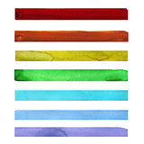 Seven rainbow colored watercolor paint strokes