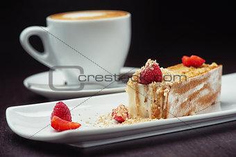 beautiful cake dessert with coffee cream and fresh berry