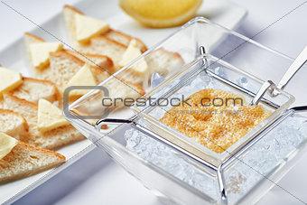 Breakfast fresh caviar on ice with toasts