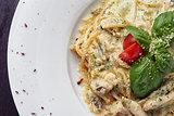 Italian spaghetti with sauce and basil leaf