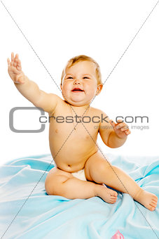 baby in diaper sitting on a blue blanket. Isolated