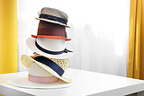 hat stack on white table in the room