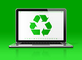 Laptop with a recycle symbol on screen. environmental conservati