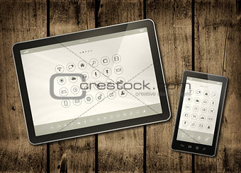 Smartphone and digital tablet PC with desktop icons on a dark wo