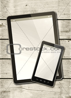 Smartphone and digital tablet PC on a white wood table
