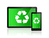 Digital tablet PC with a recycling symbol on screen. environment