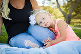 Beautiful Young Girl Resting on Her Mommy's Lap At Park