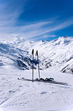 Skis and ski sticks in Alps, Austria
